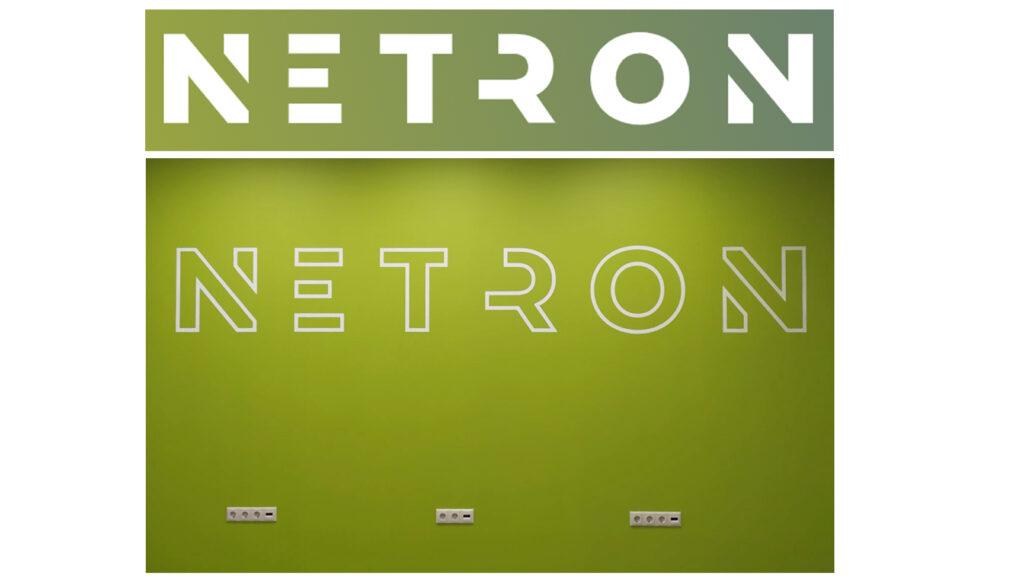 логотип компании нетрон на стене